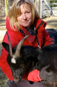 Kristeva Dowling enjoys a snuggle with her pygmy goat, Shiraz, at Howling Duck Ranch.
