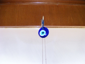 A Greek superstition called Mati where this eye is placed at your door to prevent the envy of others from cursing you