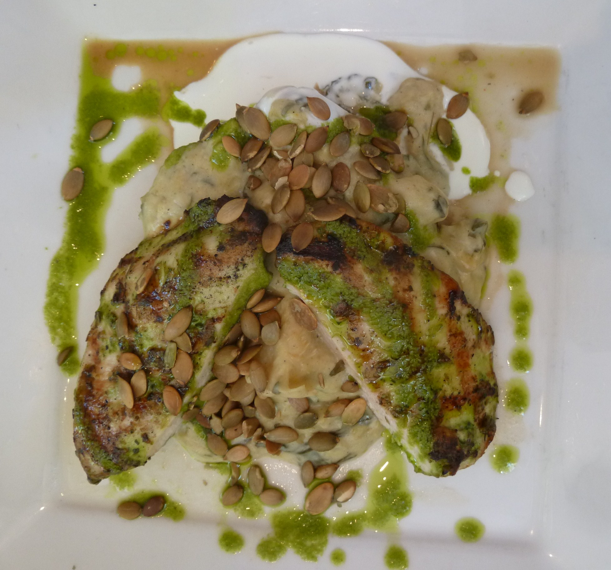 ... mushroom stuffed with artichoke gratin and goat cheese drizzle